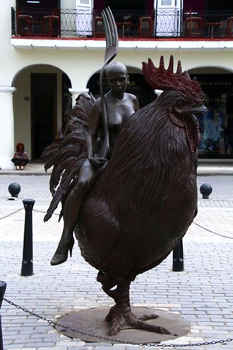 Site seeing in Havana Woman riding a rooster in Plaza Vieja